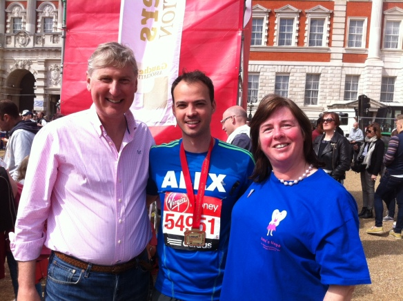 Rob and Carole Hughes with Virgin London Marathon runner Alex Goss